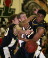 Josh Cassaday, # 24 of Smoky Hill get tangled in the middle of Mike Barry, #40, and Terrance Dent,...