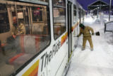 An RTD light rail commuter sits on the train at the Lincoln Station as RTD maintenance worker Bob...