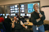 MJM869  Manager of Public Works, Bill Vidal, right, looks at a current weather forecast on a...