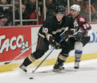 ANA102 - Anaheim Ducks' Corey Perry tries to skate away with the puck from Colorado Avalanche's...