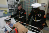 Ben Miller,6, (cq mother), lays in his bed becoming an honorary marine as Lance Corporal Michael...