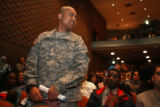 Fort Carson soldier SSGT Bedinin Joseph, cq, stands as he is recognized for being in the Armed...