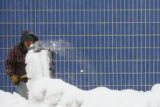 Rigo Rico shovels snow off the sidewalk in downtown Denver Friday, Dec. 29, 2006. Julio Ochoa who...