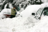 [JPM0421] Ryan Kircher (cq)digs his car out of a snow bank in Golden, Colo., on Friday, Dec. 29,...