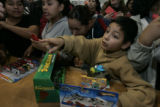 Getting to pick out what you want 'priceless', Enrique Gutirrez, 8 (cq) points to his gift  on the...