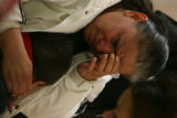 (DLM4888) -   Maria Rivas holds her two-year-old son Oscar and cries for her husband Jose Rivas...
