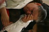 (DLM4889) -   Maria Rivas holds her two-year-old son Oscar and cries for her husband Jose Rivas...