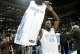 Denver Nuggets forward Reggie Evans hoist up J.R. Smith's jersey while wearing Carmelo Anthony's...