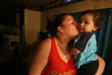 (DLM5059) -   Veronica Rodriguez, 20, kisses her 11-month-old son Luis Rodriguez at her...