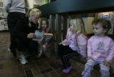 (DLM7496) -   Mindy Hartley, left, reads to her daughter, Georgia Hartley, 3, as Josephine Kenney,...