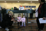 (DLM7505) -   Mindy Hartley, left, reads to her daughter, Georgia Hartley, 3, as Josephine Kenney,...