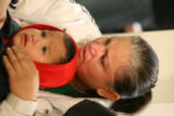 (DLM4452) -   Maria Rivas holds her two-year-old son Oscar and cries for her husband Jose Rivas...