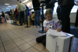 (DLM7574) -   Emily Olivier, 7, finishes writing her letter to Santa Claus as she waits in line...