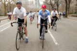 NYMA104 - Lance Armstrong, center, wearing red hat, rides a bike in New York's Central Park with...