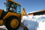 Bus driver, now back-hoe operator David Kraft, cq, digs out Eads High School  Tuesday Jan. 2, 2007...