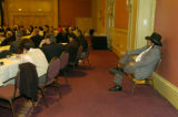 (DENVER, Colo., March 27, 2005)  Jerry Meninick (cq) (right) sits in the back of the room...