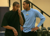 Carmelo Anthony, left, and teammate J.R. Smith, right, during a morning scrimmage at the Pepsi...