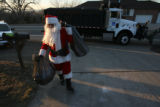 Santa (Ron Wagoner, cq), delivers presents with his truck behind. His day job is Maintenance...