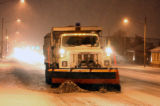 A Denver snowplow heads west in the 6,000 block of East Colfax Avenue during the early morning...