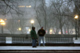 Two men  wait for the RTD bus on Colfax Avenue near Civic Center Park during the early morning...
