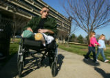 Sgt. Gregory Edwards, of the Marines, sits in his wheelchair outside Walter Reed Medical Center...