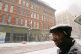 Snow storm in Denver December 20, 2006. Ken Holmes (cq) of Centennial waits for the light rail...