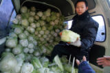 (NYT60) BEIJING -- Dec. 18, 2006 -- CHINA-CABBAGE -- A worker at the Old Drum Tower Outer Street...