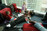 MJM549 Seth Young, 4, prepares to stay the night at DIA with sister, Dannie Young, 2, mother, Kay...