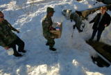 Staff Sgts. Brian Riley(CQ) and Archie White (cq) of the Colorado National Guard deliver food...