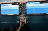 (DLM4342) -  Southwest Airlines gate attendant Jenelle Price takes to calls at once at Denver...