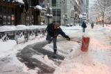 Mike Michaud (cq) clears snow from in front of the Kittredge Building on the 16th Street Mall...