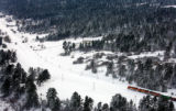 A train makes its way through a snow covered valley near Larkspur Thursday. Aerial photographs...