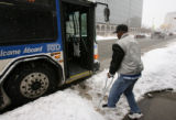 MJM123  Suffering from polio, Terry Jackson (cq), 49, navigates a path through the snow at a bus...