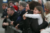 (DLM1758) -   Makenzie Lulich, 8, hugs Laura Harrington as she comes out into the main terminal at...