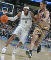 Allen Iverson ,left, drives on Sacramento's Kevin Martin, left,  in the third quarter of play as...