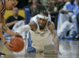 Allen Iverson dives for a loose ball against Sacramento's Kevin Martin, left,  in the third...
