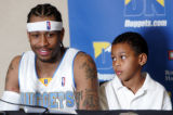 "Allen Iverson (CQ), with his son Allen II (CQ)or ""Duce"" by his side, talks to the media..."