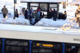 Early morning commuters wait for the RTD bus on eastbound Colfax Avenue near Braodway  on Friday...