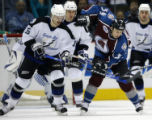 DXA105 - Tampa Bay Lightning right winger Rusian Fedotenko, left, of the Ukraine, swings at the...