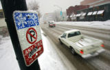 A snow route sign posted on Lincoln Street between 4th and 5th Avenues. Mayor John Hickenlooper...