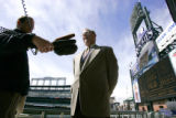 (DENVER, Co. - SHOT 3/30/2005) Kevin Kahn (center), vice president of ballpark operations for the...