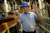 Chemical engineer Bob Wallace, cq, at the National Renewable Energy Laboratory in Golden, explains...