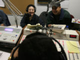 (DLM5558) -   Morning disc jockey Elda Gamez, back left seated next to her brother Simon Gamez,...
