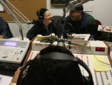 (DLM5560) -   Morning disc jockey Elda Gamez, back left seated next to her brother Simon Gamez,...