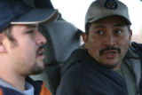 (DLM5957) -   Miguel Vasquez, left, and Humberto Fuentes, both workers at the Swift & Co....