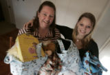 "Debbie Drury (cq) and her 16 year old daughter Ashlyn (cq)hold some of the ""goody bags""..."
