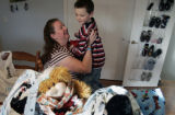 Debbie Drury (cq) hugs  her 7 year old son Dylan (cq) - who just came home from school - as she...