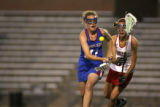 Cherry Creek High School's Catie Tilton gains posession of the ball against Kent Denver's Danielle...