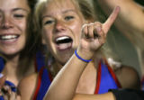 Morgan Johnson, left, and Kathryn Kepplier celebrate with the rest of the Cherry Creek High School...