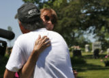 After finding the first bone fragment, Professor Mimi Wesson hugs her husband Ben Herr (cq).  In...